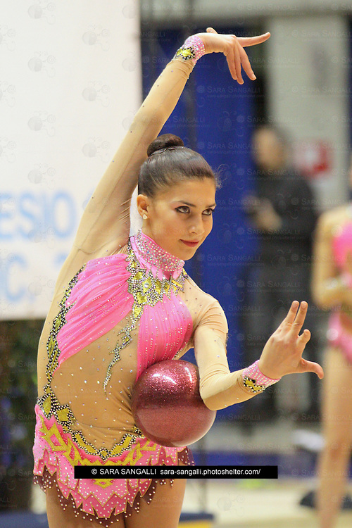 DESIO, MILAN / ITALY - DECEMBER 2012: Matteucci Martina  performs with ball, for the team Ritmica Nervianese during the Italian National Rhythmic Gymnastic Championship on 1st December, 2012 in Desio. Her score was 24,35