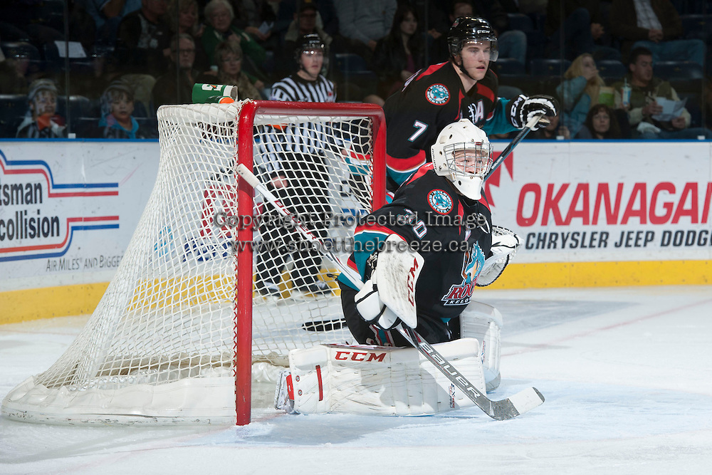 KELOWNA, CANADA - NOVEMBER 6: Jordon Cooke #30 of the Kelowna Rockets defends the net against the Red Deer Rebels on NOVEMBER 6, 2013 at Prospera Place in Kelowna, British Columbia, Canada.   (Photo by Marissa Baecker/Shoot the Breeze)  ***  Local Caption  ***