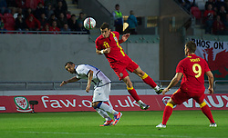 LLANELLI, WALES - Wednesday, August 15, 2012: Wales' Gareth Bale in action against Bosnia-Herzegovina's Sejad Salihovic during the international friendly match at Parc y Scarlets. (Pic by David Rawcliffe/Propaganda)