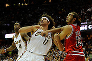 Apr 27, 2010; Cleveland, OH, USA; Cleveland Cavaliers forward Anderson Varejao (17) battles for a rebound with Chicago Bulls guard Kirk Hinrich (12) as Cleveland Cavaliers forward Antawn Jamison (4) looks on during the fourth period in game five in the first round of the 2010 NBA playoffs at Quicken Loans Arena.  Mandatory Credit: Jason Miller-US PRESSWIRE