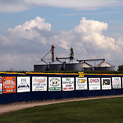 Beyond he Clarinda A's right field wall, silos and a field of corn give the stadium an Iowa flavor.  photo by David Peterson