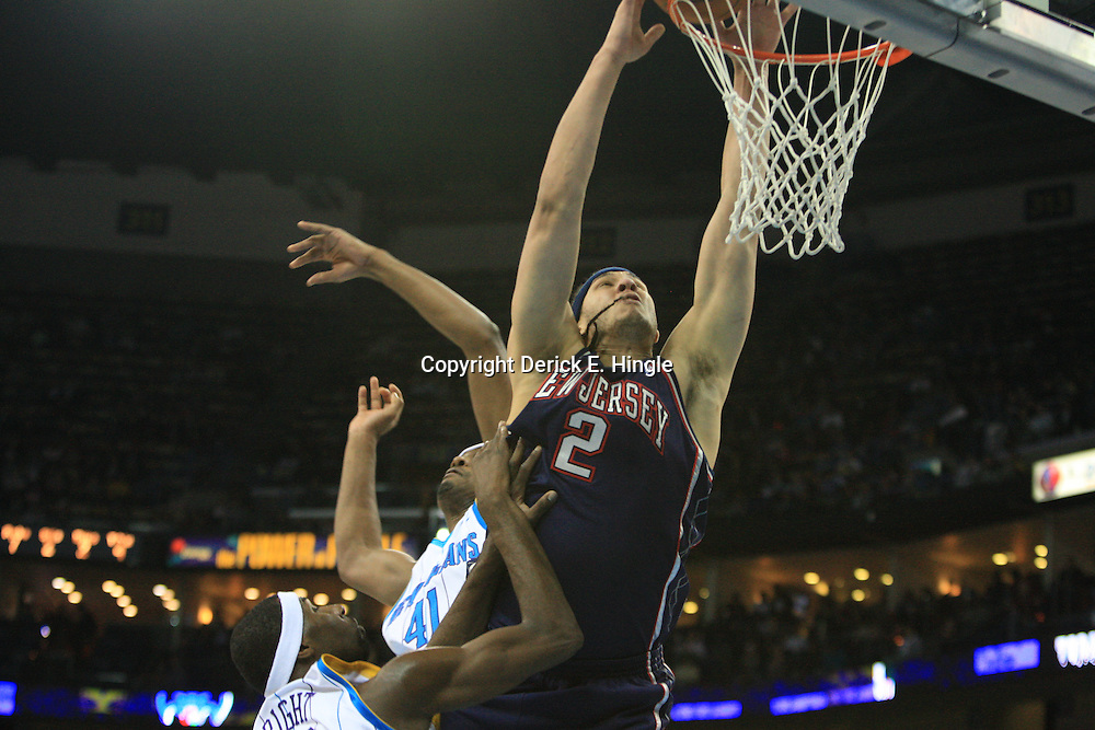 21 January 2009:  New Jersey Nets center Josh Boone (2) attempts a dunk over Hornets defenders James Posey (41) and Julian Wright during a 102-92 win by the New Orleans Hornets over the New Jersey Nets at the New Orleans Arena in New Orleans, LA. .