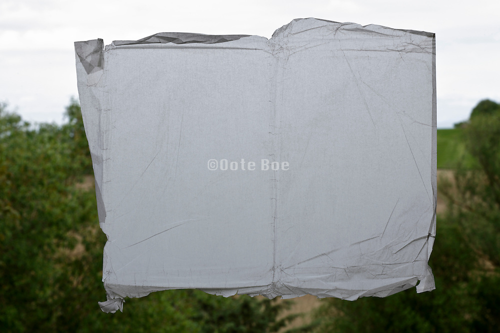 semi transparent paper blocking view towards rural countryside landscape
