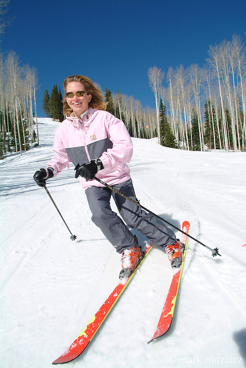 Jen skiing on groomed run at The Canyons, Park City, Utah, USA
