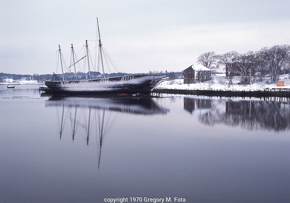 "Coal Barges lay abandoned in the bay of  Wiscasset,Maine, December, 1970. The Town of Wiscasset is the Gateway to Midcoast Maine. It's a place where a rich maritime history and a bright technological future converge in ""Maine's Prettiest Village."" 12151970. c. 1970 Gregory M. Fota"