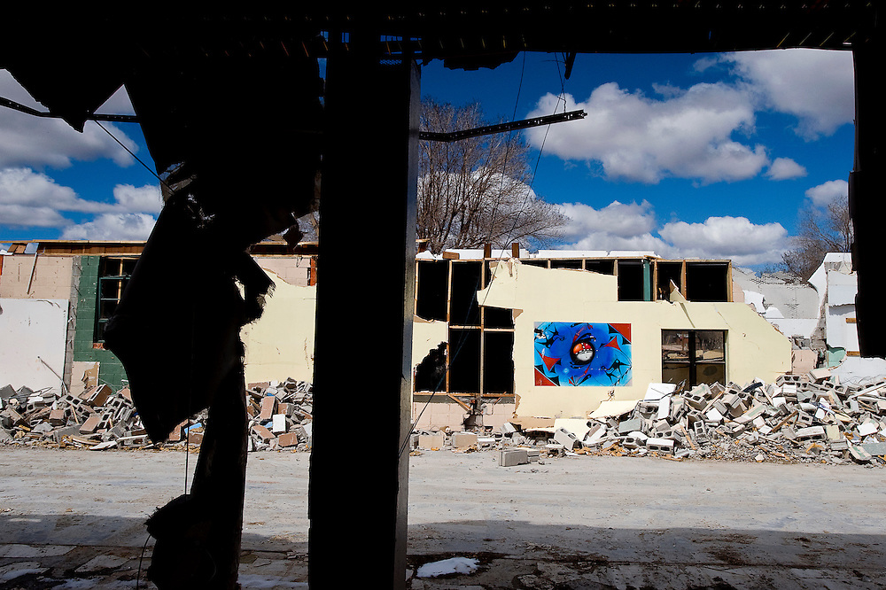 031710       Brian Leddy.A mural at the old Zuni Middle School in Zuni still stands as destruction of the school continues. Over the years the school has served as high school as well and is filled with many similar murals by Zuni artists.