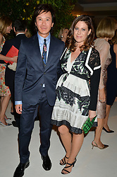 ANDY WONG and FRANCESCA VERSACE at a dinner hosted by Cartier in celebration of The Chelsea Flower Show held at The Hurlingham Club, London on 19th May 2014.