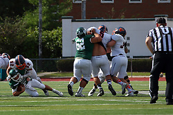 01 October 2016:  Caleb Ashby tackles Brandon Bauer  as Kyle Cook holds back a pair of Thunder during an NCAA division 3 football game between the Wheaton Thunder and the Illinois Wesleyan Titans in Tucci Stadium on Wilder Field, Bloomington IL (Photo by Alan Look)