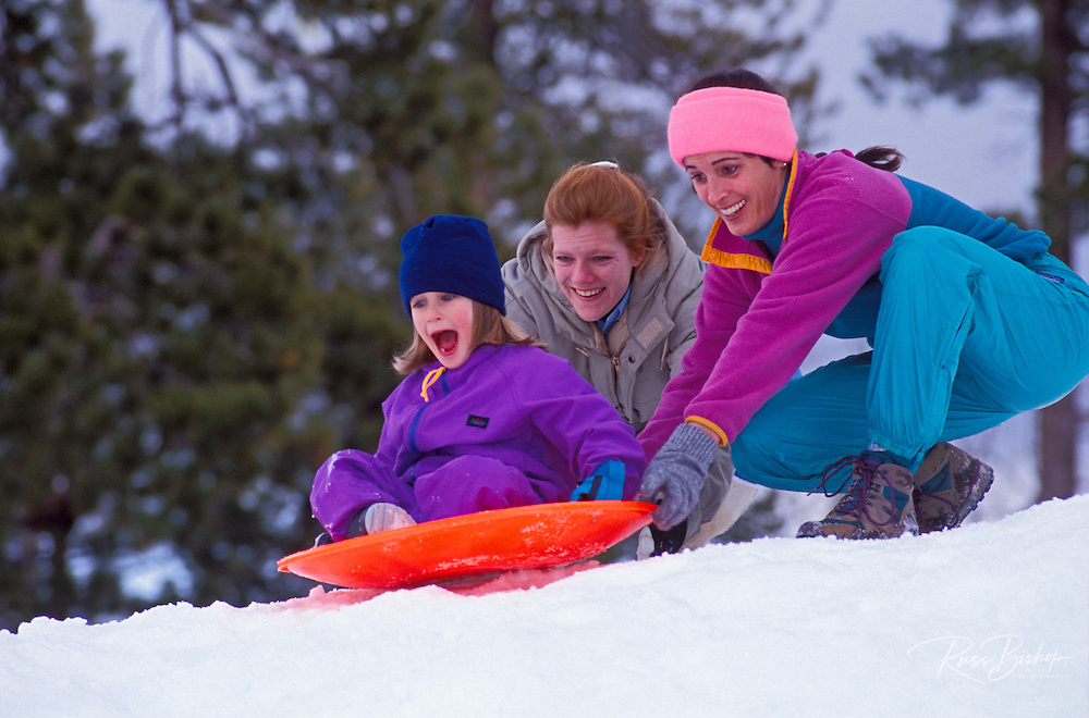 Mothers and child (age 5) playing in the snow, San Bernardino National Forest, California