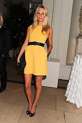 POPPY DELEVINGNE at a reception to present the new Cartier Tank Watch Collection held at The Orangery, Kensington Palace Gardens, London W8 on 19th April 2012.