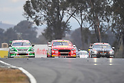 19th May 2018, Winton Motor Raceway, Victoria, Australia; Winton Supercars Supersprint Motor Racing; Rick Kelly takes the lead over Scott McLaughclin during race 13 of the 2018 Supercars Championship