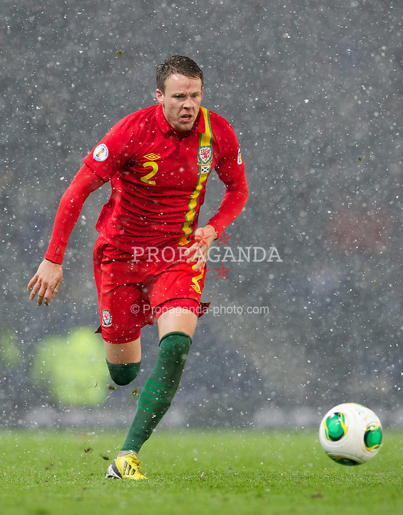 GLASGOW, SCOTLAND - Friday, March 22, 2013: Wales' Chris Gunter in action against Scotland during the 2014 FIFA World Cup Brazil Qualifying Group A match at Hampden Park. (Pic by David Rawcliffe/Propaganda)
