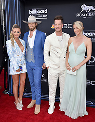 Brittney Marie Cole, Brian Kelley and Tyler Hubbard of Florida Georgia Line, and Hayley Stommel attend the 2019 Billboard Music Awards at MGM Grand Garden Arena on May 1, 2019 in Las Vegas, Nevada. Photo by Lionel Hahn/ABACAPRESS.COM