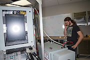 David Ogden, Staff and Masters Student in Mechanical Engineering works on ... Photo by Ben Siegel