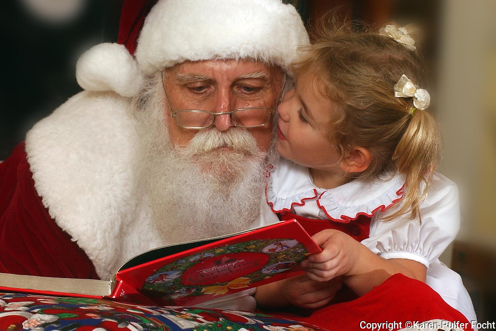 Elli Rose Focht and Santa Clause read together.