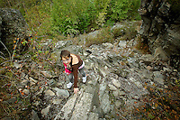 Rheana Pollos climbs up one of the rocky trails Monday, Sept. 20, 2010 while on an assignment with her father at Q'emiln Park in Post Falls, Idaho.