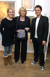 Left to right, LAURA PARKER BOWLES, her mother HRH the DUCHESS OF CORNWALL and artist JONATHAN YEO at an exhibition of artist Jonathan Yeo's portrait paintings held at Eleven, 11 Eccleston Street, London SW1 on 16th February 2006.<br />