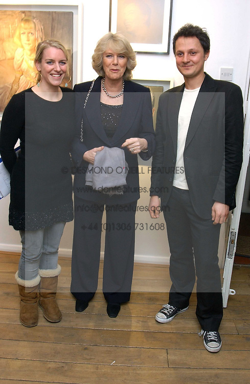 Left to right, LAURA PARKER BOWLES, her mother HRH the DUCHESS OF CORNWALL and artist JONATHAN YEO at an exhibition of artist Jonathan Yeo's portrait paintings held at Eleven, 11 Eccleston Street, London SW1 on 16th February 2006.<br /><br />NON EXCLUSIVE - WORLD RIGHTS