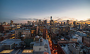 View of Downtown Manhattan and the Freedom Tower from SoHo rooftops at sunset, New York