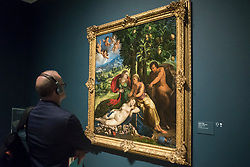 "© Licensed to London News Pictures. 28/02/2019. LONDON, UK. A visitor views ""A Myth of Pan"", 1524 by Dosso Dossi. Preview of ""The Renaissance Nude"", an exhibition at the Royal Academy of Arts in Piccadilly of 90 works examining the emergence of the nude in European art.  Works by artists including Leonardo da Vinci to Michelangelo are on display in the Sackler Galleries 3 March to 2 June 2019.  Photo credit: Stephen Chung/LNP"