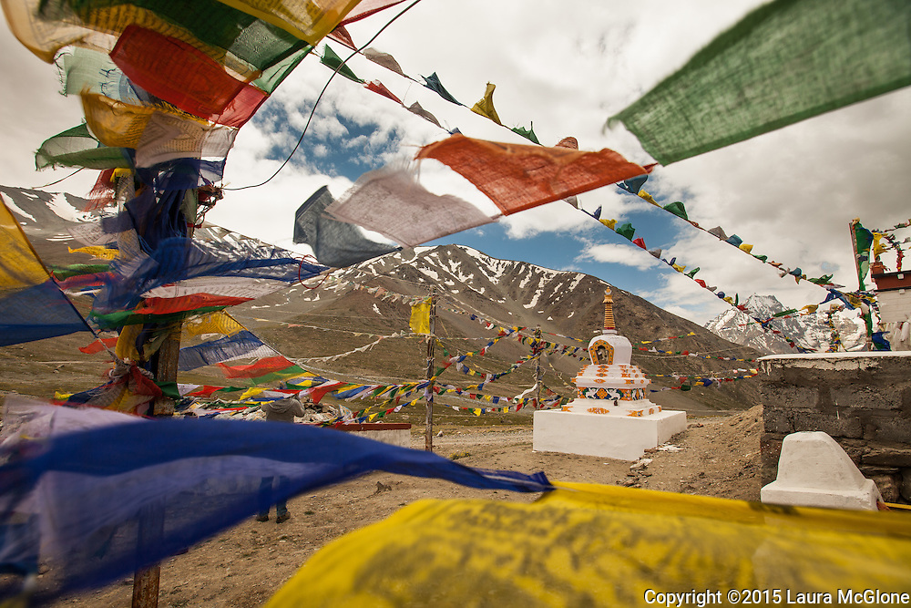 Prayer Flags fluttering in the wind & stupa, Himalayan Mountains, India