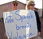 tucsonshooting - 09 JANUARY 2011 - TUCSON, AZ: Richard Fridena (CQ) and his wife, Betty Fridena, (CQ) and other members of the Pima Friends Meeting (Quakers) stand on the corner of Speedway and Euclid in Tucson Sunday protesting against hate speech that they say led to the mass shooting in Tucson Saturday.   ARIZONA REPUBLIC PHOTO BY JACK KURTZ
