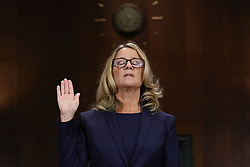 September 27, 2018 - Washington, DC, U.S. - Dr. CHRISTINE BLASEY FORD, 51, is sworn in before testifying the Senate Judiciary Committee in the Dirksen Senate Office Building on Capitol Hill. A professor at Palo Alto University and a research psychologist at the Stanford University School of Medicine, Ford has accused Supreme Court nominee Judge Kavanaugh of sexually assaulting her during a party in 1982 when they were high school students in suburban Maryland. (Credit Image: © Win Mcnamee/Pool via ZUMA Wire)
