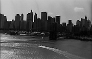 """New York City skyline seen from the Manhattan Bridge over the East River...Part of long-term (2005-2008) story """"I See A Darkness"""". New York, NY."""
