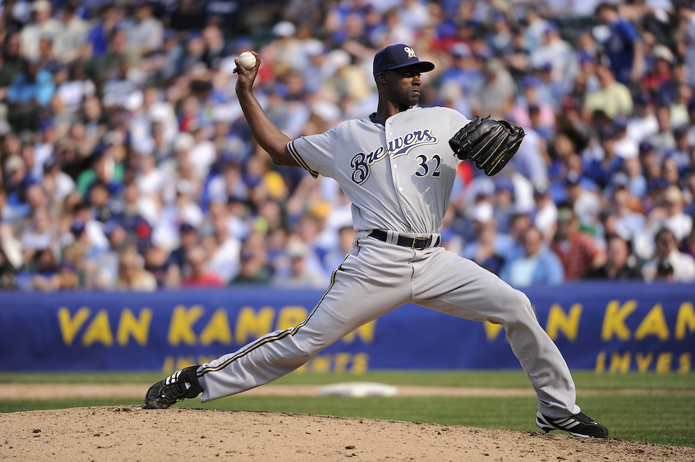 CHICAGO - APRIL 14:  LaTroy Hawkins #32 of the Milwaukee Brewers pitches against the Chicago Cubs on April 14, 2010 at Wrigley Field in Chicago, Illinois.  The Cubs defeated the Brewers 7-6.   (Photo by Ron Vesely)