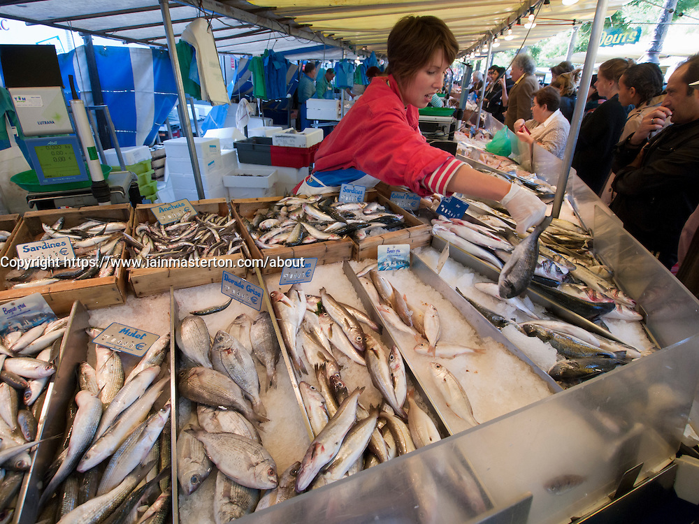 Fish stall at traditional market at Bastille in Paris France