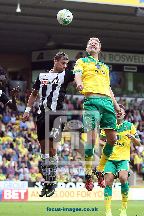 Michael Turner of Norwich heads for goal during the Sky Bet Championship match at Carrow Road, Norwich<br /> Picture by Paul Chesterton/Focus Images Ltd +44 7904 640267<br /> 16/08/2014