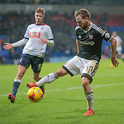 Alan Judge (Brentford) controls the ball having beaten the Bolton defence only to see the offside flag raised during the Sky Bet Championship match between Bolton Wanderers and Brentford at the Macron Stadium, Bolton, England on 30 November 2015. Photo by Mark P Doherty.