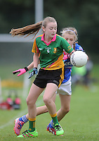 21 Aug 2016: Megan Clarke, Meath, in action against Muireann McCague, Monaghan.   Girls U12 Gaelic football final, Skryne, Meath (blue) v Clontibret, Monaghan (green).  2016 Community Games National Festival 2016.  Athlone Institute of Technology, Athlone, Co. Westmeath. Picture: Caroline Quinn