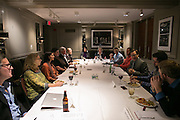 """Jonathan Binstock, director of the Memorial Art Gallery, speaks with a group of young professionals at the Gallery on Thursday, November 6, 2014. The group, called """"The Tribe,"""" was brought together to help empower millennials in shaping the future of Rochester's cultural attractions."""