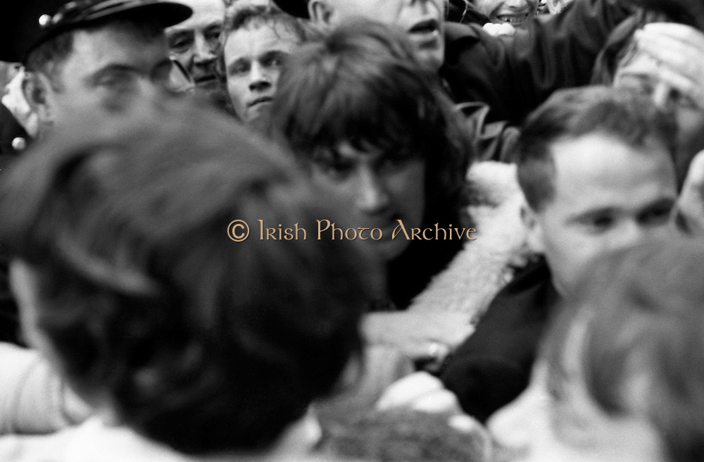 George Best opens Penney's Foodhall.<br /> 1970.<br /> 18.08.1970.<br /> 08.18.1970.<br /> 18th August 1970.<br /> Manchester United and Northern Ireland footballer, George Best,is mobbed by adoring fans as he opens Penney' New Foodhall in Henry Street, Dublin.