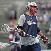 A member of the Boston Cannons warms up prior to the game at Harvard Stadium on May 10, 2014 in Boston, Massachusetts. (Photo by Elan Kawesch)
