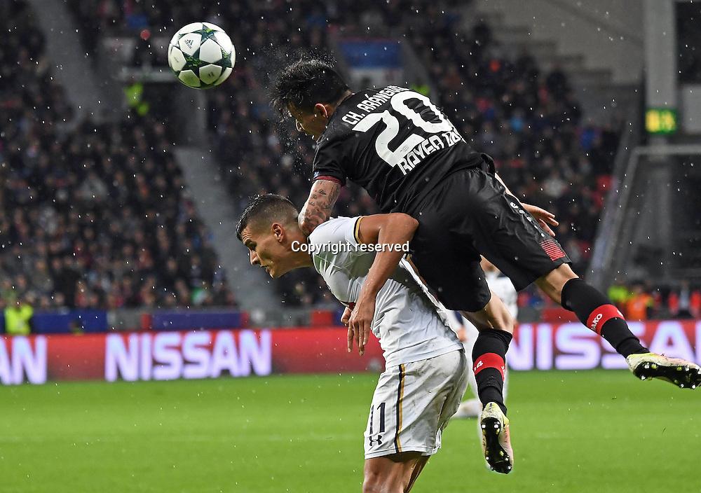 18.10.2016. Leverkusen, Germany. UEFA Champions League footbll. Bayer Leverkusen versus Tottenham Hotspur. Erik Lamela (Tottenham Hotspur) is climbed on by Charles Aranguiz (Bayer Leverkusen)