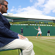 LONDON, ENGLAND - JULY 13:  Katie Swan of Great Britain in action against Whitney Osuigwe of the United States as a line judge watches in the Girls' Singles Tournament during the Wimbledon Lawn Tennis Championships at the All England Lawn Tennis and Croquet Club at Wimbledon on July 13, 2017 in London, England. (Photo by Tim Clayton/Corbis via Getty Images)