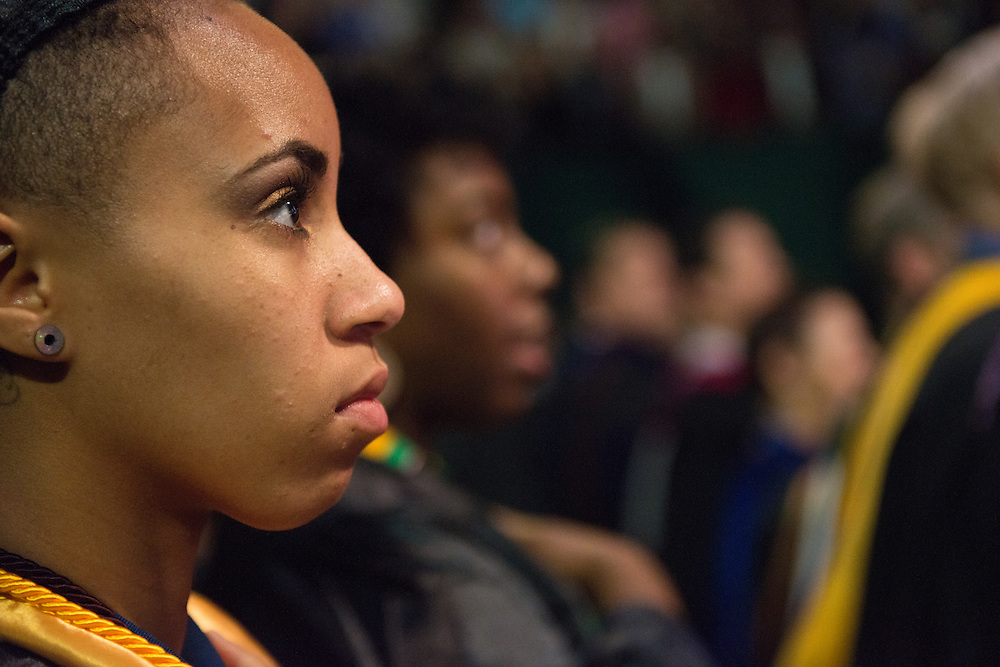 Jasmine Craig listens to President McDavis speak at undergraduate commencement. Photo by Ben Siegel