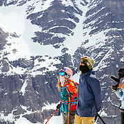 Matt Hines films Lynsey Dyer and Griffin Post watching Andy Mahre getting ready to ski in Glacier National Park.