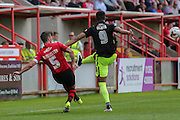 defender Jamie McAllister clears from forward Vadaine Oliver during the Sky Bet League 2 match between Exeter City and York City at St James' Park, Exeter, England on 22 August 2015. Photo by Simon Davies.