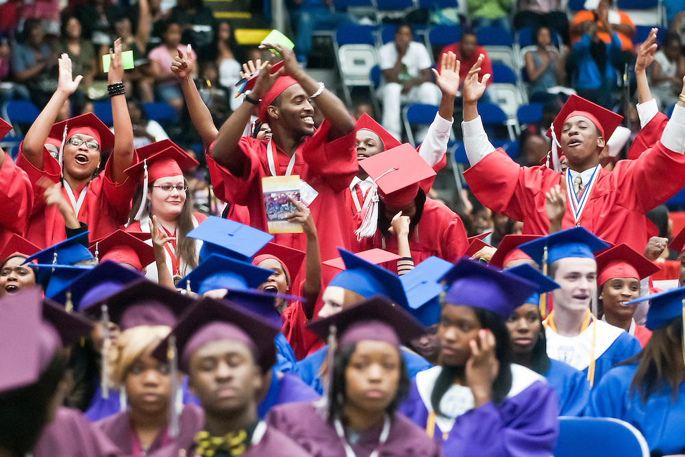 Lathan Goumas | MLive.com..Northern High School graduates cheer during the 2012 Flint Community Schools commencement ceremony at the Perani Arena in Flint, Mich. on Tuesday June 5, 2012.