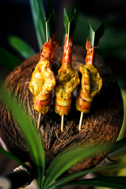 Charcoal-grilled prawn satay on a coconut shell at the Six Senses Resort in Koh Samui, Thailand.