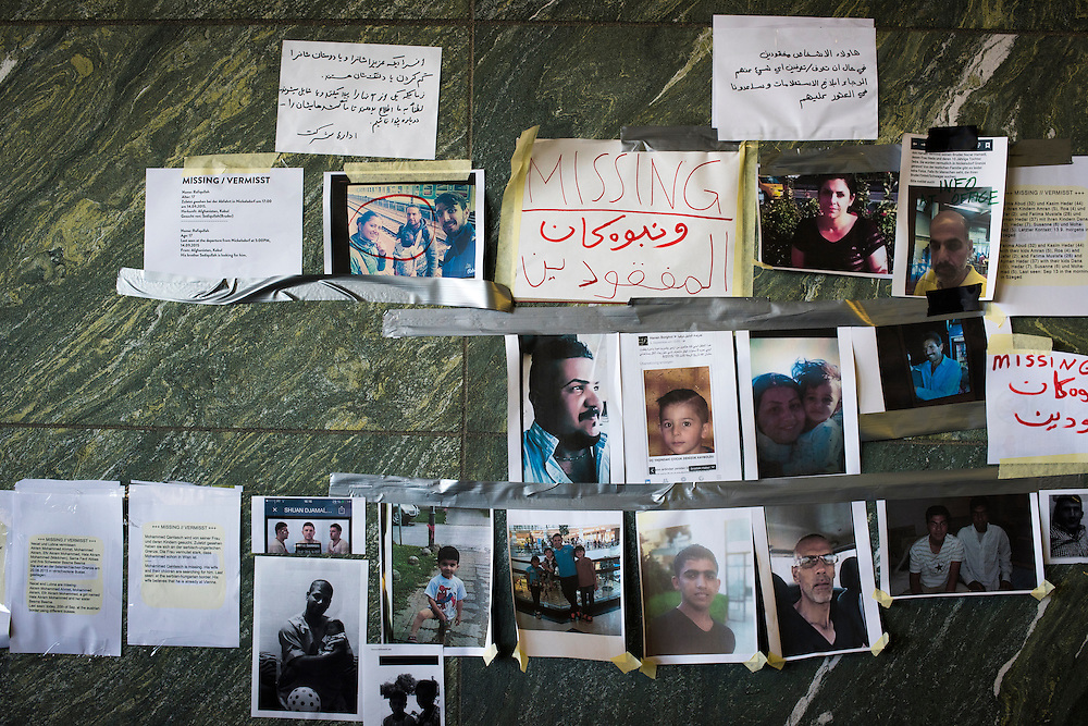Flyers on a wall, written in Arabic, German and English,  seek information on missing persons at the east entrance of Wien Hauptbahnhof train station on September 22, 2015 in Vienna, Austria. While the west side of the station features long lines as migrants wait to purchase tickets to Germany and other locations in Europe, the east entrance of the station has been converted into a refugee center, featuring a kitchen, a childcare center, legal aid and a clothes distribution area.