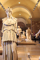 Ancient Greek statues on display at The Louvre Museum in Paris, France.