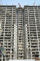 Abandoned and unfinished office building construction site in Doha Qatar
