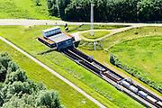 Nederland, Gelderland, Duiven, 09-06-2016; Groessen, natuurgebied Kandia. Goederentrein op Betuweroute nadert de tunnel onder Pannerdens kanaal. Naast het dienstgebouw van de tunnel onder het Pannerdensch kanaal, De Mammoet (Kunstenaar Joris Baudoin).<br /> Tunnel Betuweroute, freight railway, Pannerdensch channel (Lower Rhine) on the horizon.<br /> <br /> luchtfoto (toeslag op standard tarieven);<br /> aerial photo (additional fee required);<br /> copyright foto/photo Siebe Swart