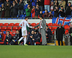 Gareth Bale of Wales (Real Madrid) shakes Wales Manger Chris Coleman hand after coming off the field. - Photo mandatory by-line: Alex James/JMP - Tel: Mobile: 07966 386802 05/03/2014 - SPORT - FOOTBALL - Cardiff - Cardiff City Stadium - Wales v Iceland - International Friendly