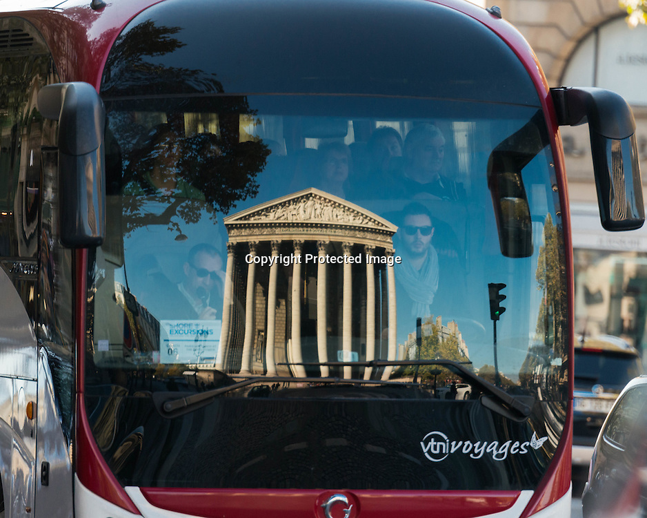 Paris, The Madeleine church , reflected on a bus.