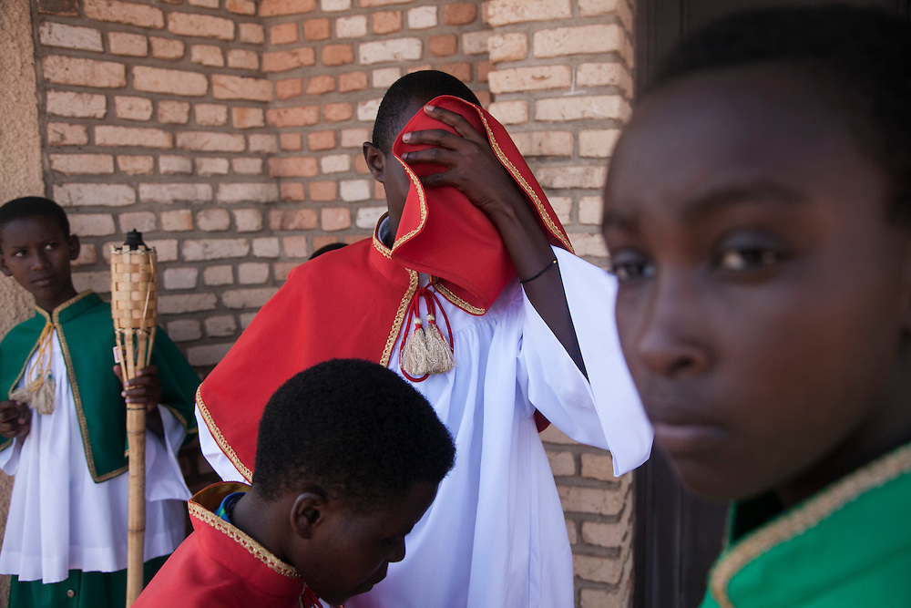 (Left to right): Altar servers Marie Louise Umubyeyi, Eugenie Mukayizera, Bosco Kabalisa and Marie Claire Radkunda wait behind the church for the start of mass at The Shrine of Our Lady of Sorrows in Kibeho, Rwanda. This is the only sanctioned Marian sanctuary in Africa. Kibeho's overseers and the Rwandan government hope this place will become a top tourism site. <br /> <br /> Photographed, Sunday, October 26, 2014.<br /> <br /> Photo by Laura Elizabeth Pohl